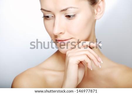 studio shot of a beautiful young woman - stock photo