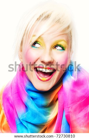 Studio shot of a blond woman with colorful makeup - stock photo