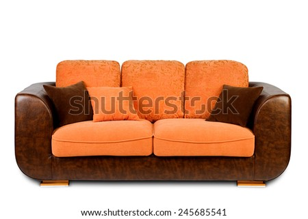 Studio shot of a brown and orange colored modern sofa with pillows on white background - stock photo