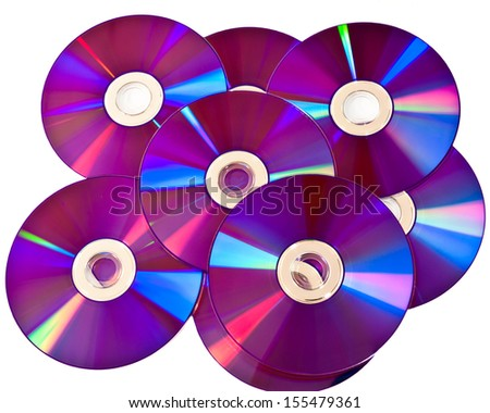 Studio shot of a bunch of purple empty DVD discs with colorful glares against white background. - stock photo