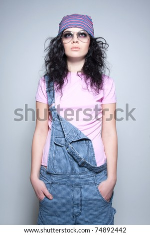 Studio shot of a casual young brunette - stock photo