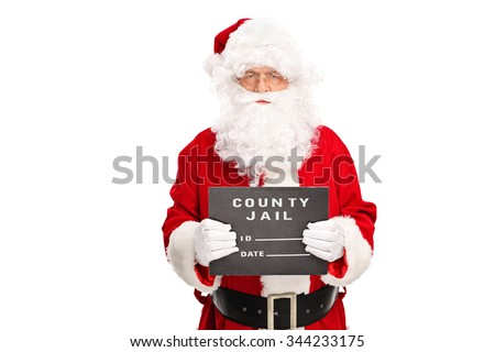 Studio shot of a criminal Santa Claus posing for a mug shot with a black board in his hand isolated on white background - stock photo
