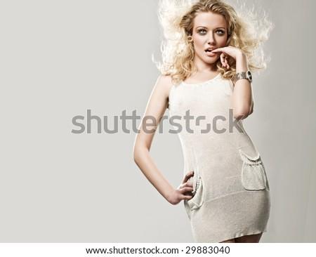 Studio shot of a cute blonde - stock photo