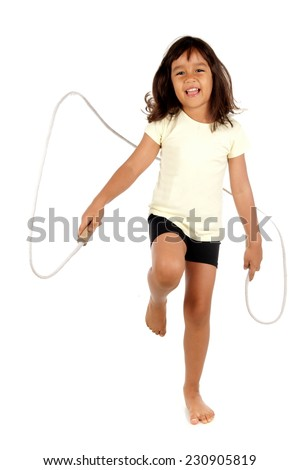 Studio shot of a cute Child playing rope - stock photo