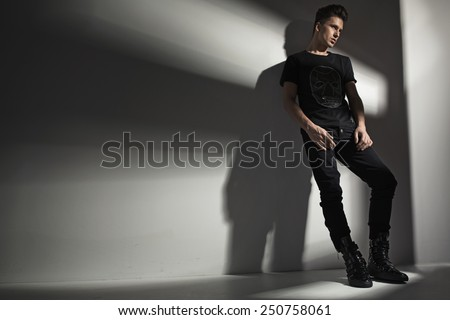 Studio shot of a fashionable man - stock photo