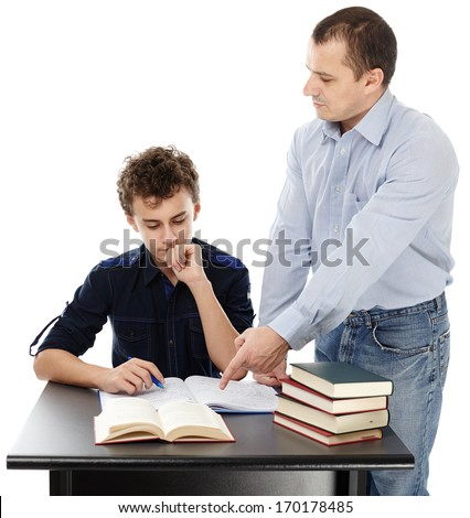 Studio shot of a father standing near son's desk helping him doing his homework, isolated over white background