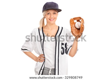 Studio shot of a female baseball player holding a ball in a baseball glove isolated on white background - stock photo