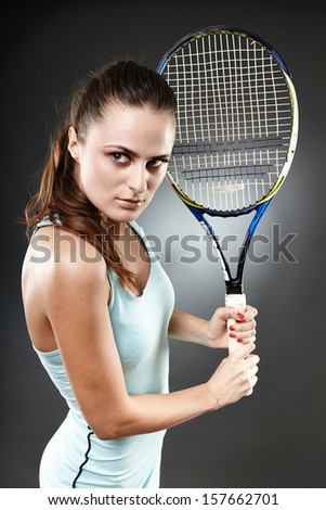 Studio shot of a female tennis player preparing to execute a backhand volley - stock photo