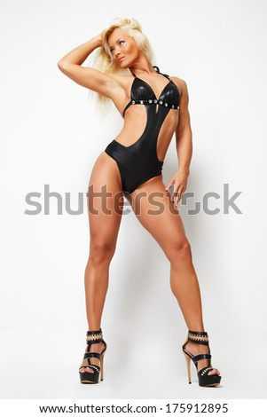 Studio shot of a fit blonde - stock photo