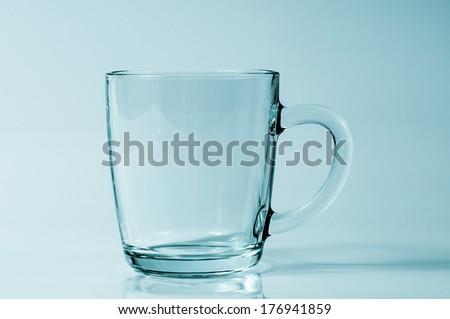Studio shot of a glass mug - stock photo