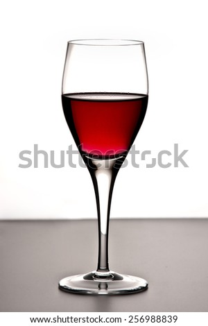 Studio shot of a glass of red wine - stock photo