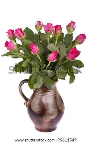 studio-shot of a handmade ceramic flower pot in a retro style, with roses. isolated on a white background. - stock photo