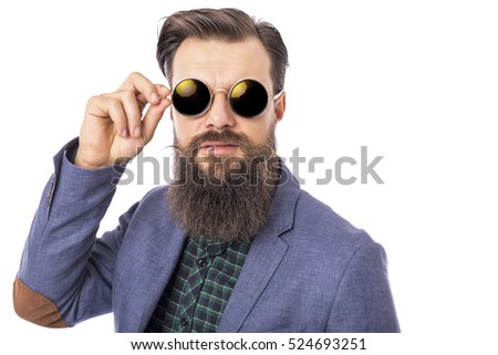 Studio shot of a handsome stylish man with beard and mustache wearing sunglasses over white