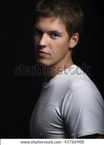 Studio shot of a handsome young male model - stock photo