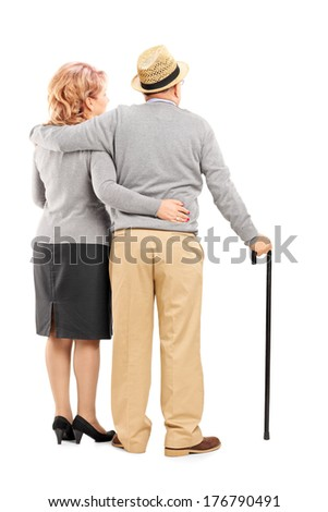 Studio shot of a happy senior couple hugging isolated on white background, rear view - stock photo
