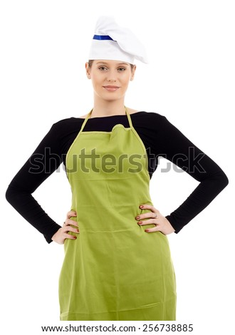 Studio shot of a happy young woman cook standing akimbo, isolated on white background - stock photo