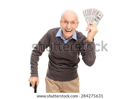 Studio shot of a joyful senior holding a stack of money and  looking at the camera isolated on white background - stock photo