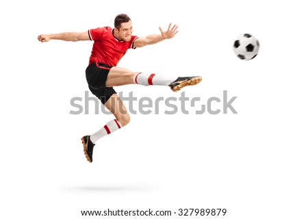 Studio shot of a male football professional kicking a ball in mid-air isolated on white background - stock photo