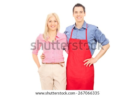 Studio shot of a man with a red apron posing with his blond girlfriend isolated on white background - stock photo