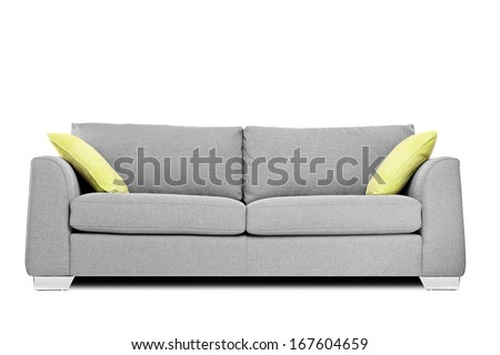 Studio shot of a modern couch with pillows isolated on white background - stock photo