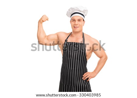 Studio shot of a naked chef with a black apron showing his biceps and looking at the camera isolated on white background - stock photo