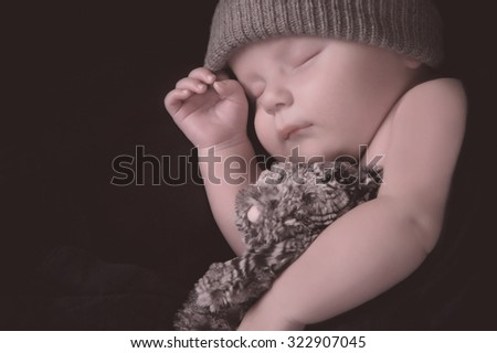 Studio shot of a newborn boy sleeping - stock photo