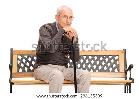 Studio shot of a pensive senior gentleman sitting on a bench and thinking isolated on white background - stock photo
