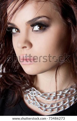 Studio shot of a pretty brunette - stock photo