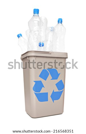Studio shot of a recycle bin full of plastic bottles isolated on white background - stock photo
