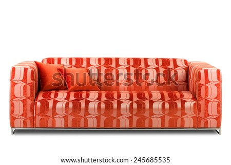 Studio shot of a red modern sofa with pillows on white background - stock photo