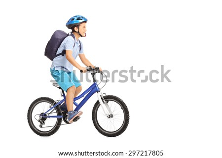 Studio shot of a schoolboy with a helmet and a blue backpack riding a bike isolated on white background - stock photo