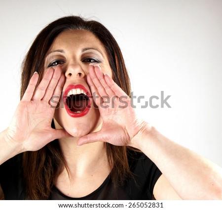 Studio shot of a screaming lady on white background - stock photo