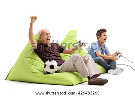 Studio shot of a senior man playing video games with his grandson isolated on white background