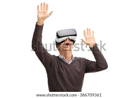 Studio shot of a senior man using a VR headset isolated on white background - stock photo