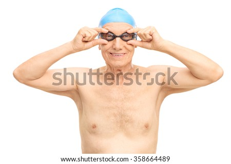 Studio shot of a senior man with a blue swim cap and black swimming goggles isolated on white background - stock photo