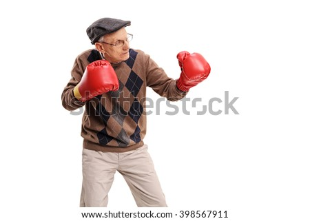 Studio shot of a senior man with red boxing gloves isolated on white background - stock photo