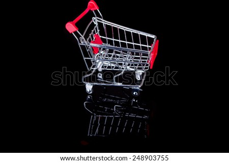Studio shot of a  shopping cart isolated over white - stock photo