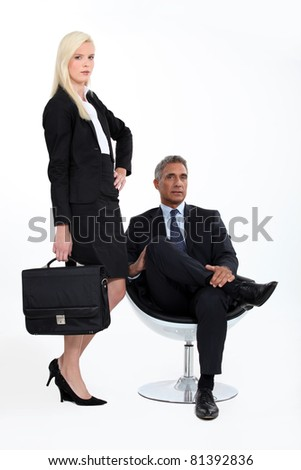 Studio shot of a smart business duo - stock photo