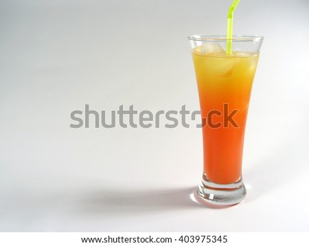Studio shot of a Tequila Sunrise cocktail containing orange juice, tequila and grenadine syrup.