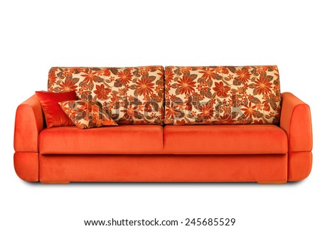 Studio shot of a two-colored modern sofa with pillows on white background - stock photo