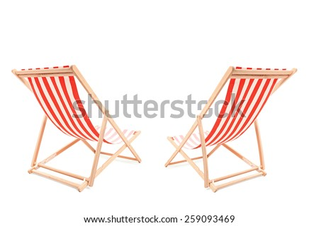 Studio shot of a two sun loungers isolated on white background - stock photo