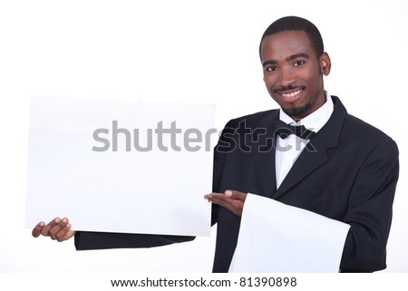 Studio shot of a waiter with a board left blank for your image - stock photo