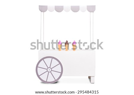 Studio shot of a white ice cream stand with a few ice cream cones left on it isolated on white background - stock photo