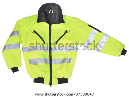 studio shot of a yellow and black neon coat with reflectors, cutout with clipping path - stock photo