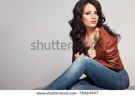 Studio shot of a young, beautiful, brunette, fashionable woman - stock photo