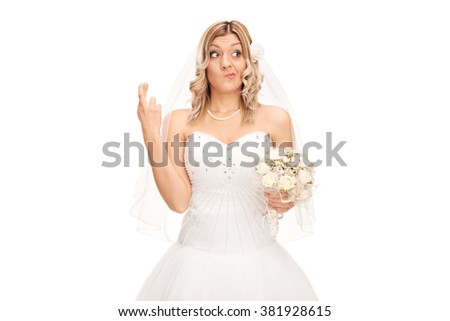 Studio shot of a young bride with her fingers crossed isolated on white background - stock photo