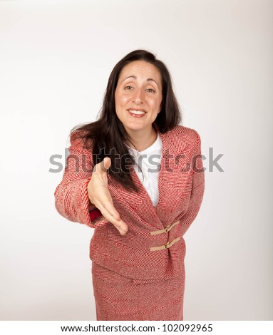 Studio shot of a young businesswoman  with an outstretched hand - stock photo