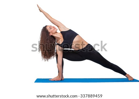 Studio shot of a young fit woman doing yoga exercises isolated on white background - stock photo