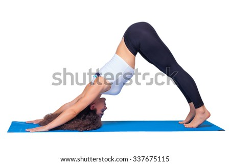 Studio shot of a young fit woman doing yoga exercises on white background