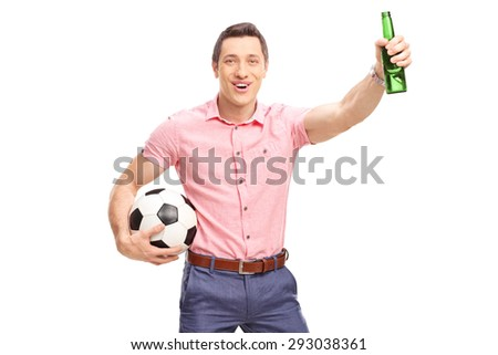 Studio shot of a young football fan holding a bottle of beer and cheering isolated on white background